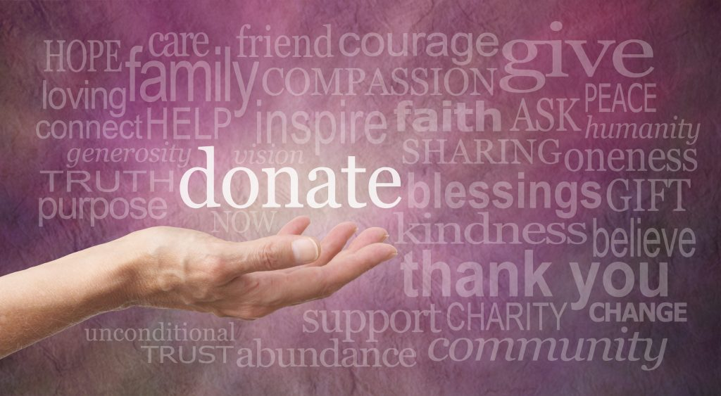 """Hand holding word """"Donate"""", cancer donations to Hearth Place"""