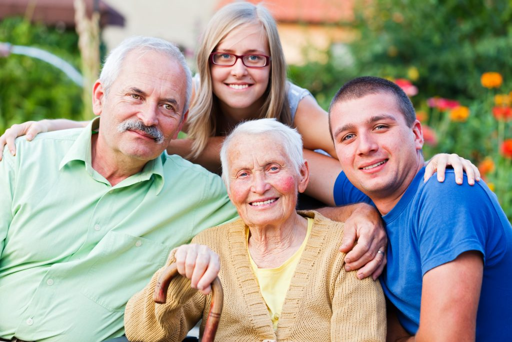 Generations in one image: grandmother, son and young grandchildren